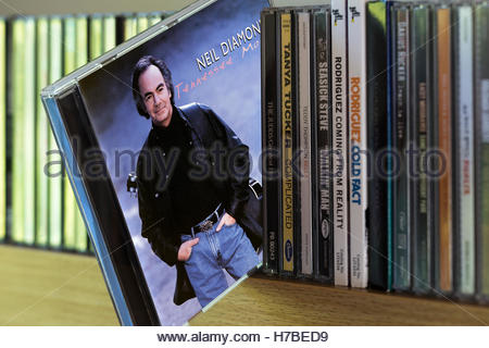 Tennessee Moon, Neil Diamond CD pulled out from among other CD's on a shelf - Stock Photo
