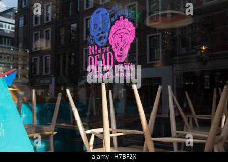 Day of the Dead promotion in a restaurant window following a suspected outbreak of norovirus, several branches of - Stock Photo