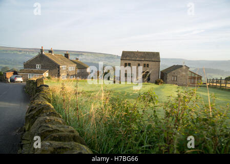 Rural country scene on clear summers day with road and sry stone wall. - Stock Photo