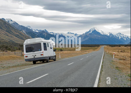 Motorhome on Mount Cook Road (State Highway 80) along the Tasman River leading to Aoraki / Mount Cook National Park - Stock Photo