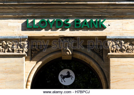 Looking up at the sign above the entrance to the Blue Boar Row, Salisbury, Wiltshire Branch of Lloyds Bank - Stock Photo