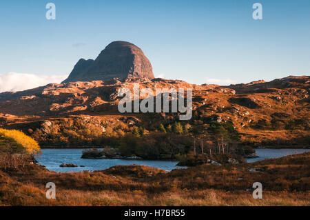 A landscape image looking across Loch Druim Suardalain to Suilven, a mountain in Assynt, in the Scottish highlands. - Stock Photo