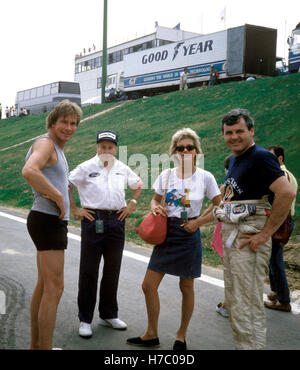 James Hunt in Shorts Teddy Mayer, Alan Jones - Stock Photo