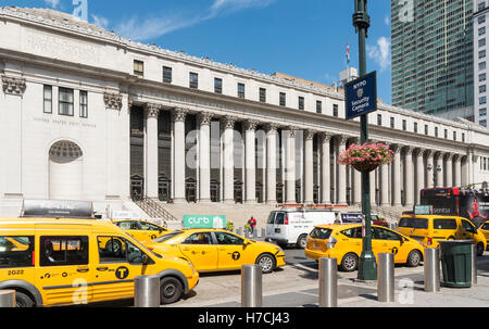 Yellow New York taxis in front of the James A. Farley Post Office Building on 34th Street. - Stock Photo