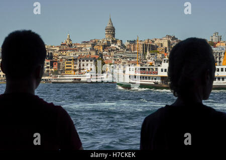 Partial view of Istanbul across the Golden Horn.  Galata Tower can be seen dominating the skyline at the top centre - Stock Photo