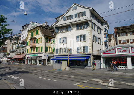 Zurich, Switzerland - August 22, 2010: Traditional buildings on the Limmatquai quay in historic part of city. - Stock Photo