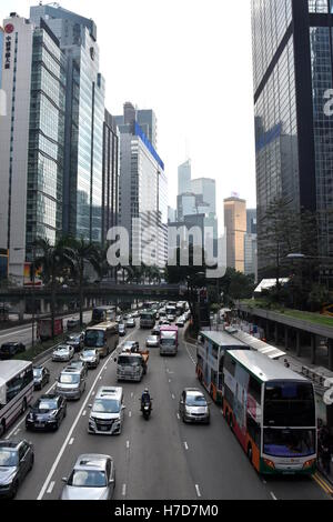 Hong Kong, China - Oct 29, 2016: Road traffic and Skyscrapers on Gloucester Road, Hong Kong Island. - Stock Photo