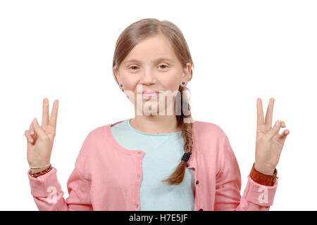 young girl showing her hands by doing victory gesture - Stock Photo