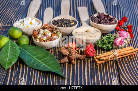 Aromatic flower tea in spoon on rustic  background - Stock Photo