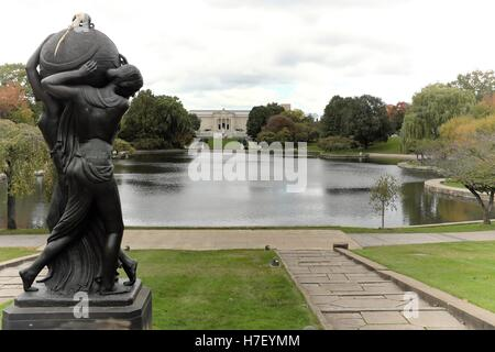 Fall begins in the Wade Park Lagoon with the Cleveland Art Museum and Frank Jirouch's 1928 bronze sculpture, Night - Stock Photo