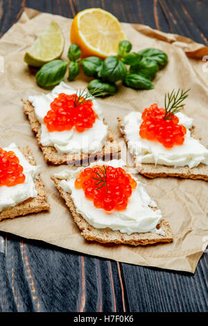 Canapes with red caviar - Stock Photo