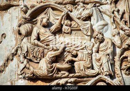 Bas-relief sculpture panel of the Nativity by Maitani, circa1310, Tuscan Gothic,  facade Orvieto Duomo Cathedral, - Stock Photo