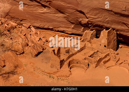 Ruins of out buildings of the Mummy cave ruins in Canyon De Chelly.  These are well preserved.  Background of red - Stock Photo