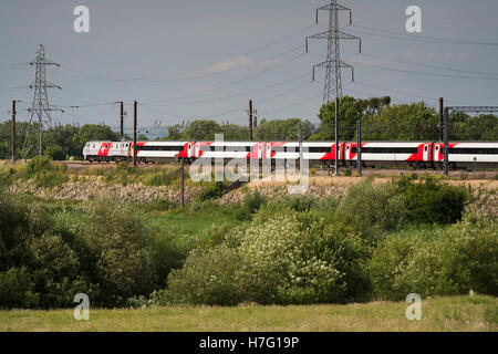 Virgin InterCity 225 electric high speed train, traveling through countryside on the  East Coast Line near York, - Stock Photo