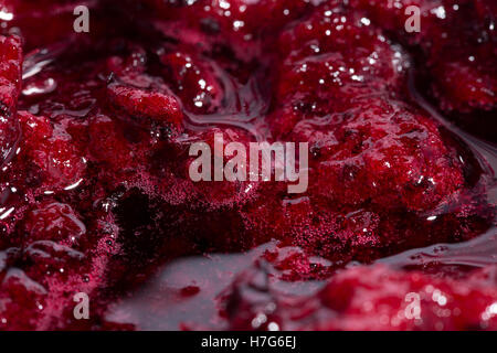 Black currant jam with bubbles close up - Stock Photo