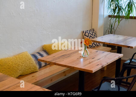 Bench Seating At A Coffee Shop Restaurant With Small Cafe Tables And  Pillows.   Stock