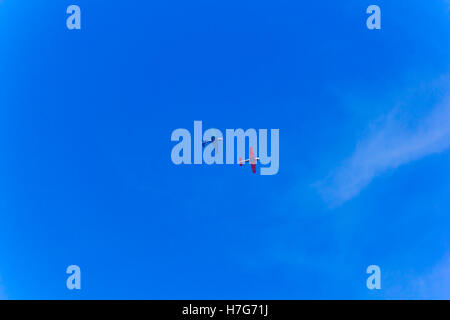 Photo of two flying military airplanes in blue sky - Stock Photo
