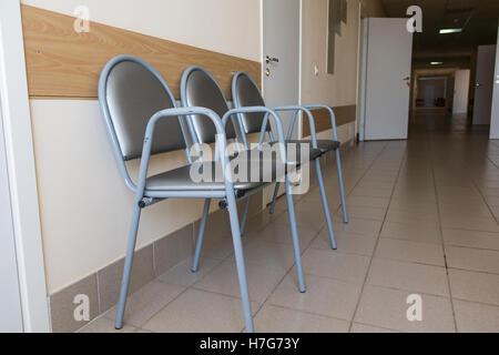 Photo of row chairs in empty corridor - Stock Photo