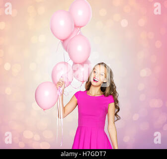 happy young woman or teen girl with balloons - Stock Photo