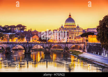 San Pietro Basilica and Ponte St Angelo at sunset. Rome, Italy - Stock Photo