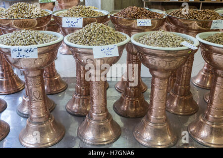 metal containers of nuts at shop - Stock Photo