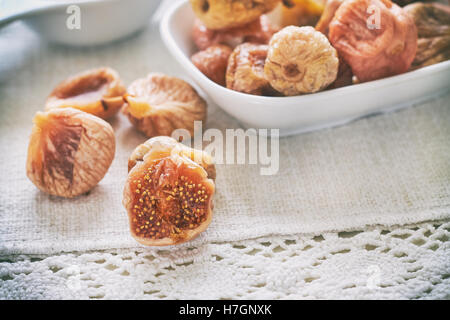 Dried figs in white bowl on table - Stock Photo