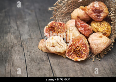 Dried figs on grey rustic wooden background. Copy space - Stock Photo