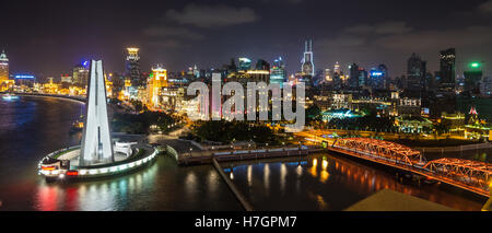 Aerial panorama at night of the Bund with Waibaidu bridge and Monument to the People's Heroes, Shanghai, China - Stock Photo