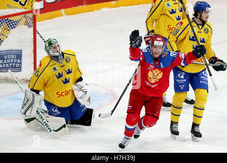 Helsinki, Finland. 5th Nov, 2016. Sweden's goaltender Niklas Svedberg (L) concedes a goal in their 2016/17 Euro - Stock Photo