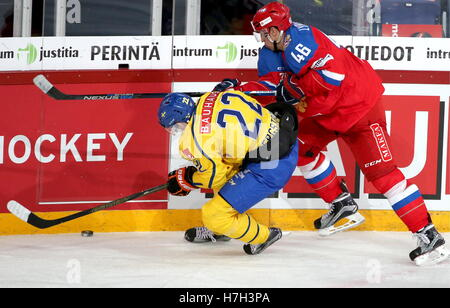 Helsinki, Finland. 5th Nov, 2016. Sweden's Alexander Bergstrom (L) and Russia's Ilya Lyubushkin fight for the puck - Stock Photo