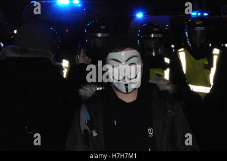 London, UK, 5th November, 2016. A masked protester  at the Million Mask protest, defies a police dispersal order. - Stock Photo