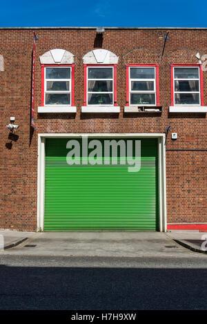 Green roller shutter, Southampton, England, UK - Stock Photo