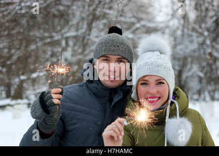 couple with sparklers on the street - Stock Photo
