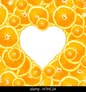 Overlapping slices of oranges arranged into a heart-shaped background - Stock Photo