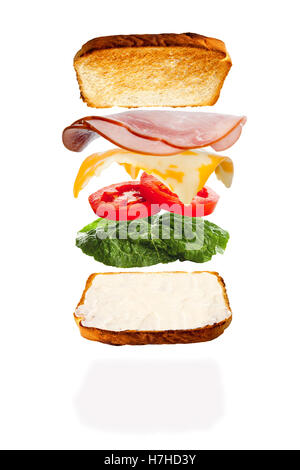 All the ingredients of a melted cheese and ham sandwich falling into place - Stock Photo