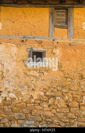 Medieval adobe house facade in Calatanazor, Spain - Stock Photo