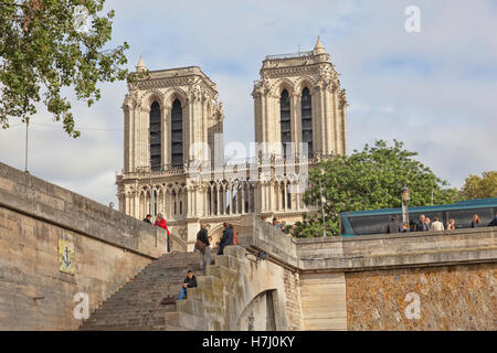 Cathedral Notre Dame, As viewed from the tour boat on the river Seine in  Paris,  France - Stock Photo