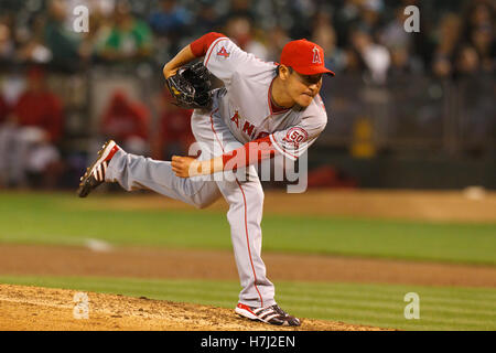 September 13, 2011; Oakland, CA, USA;  Los Angeles Angels relief pitcher Hisanori Takahashi (21) pitches against - Stock Photo