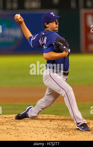 September 20, 2011; Oakland, CA, USA;  Texas Rangers starting pitcher Derek Holland (45) pitches against the Oakland - Stock Photo