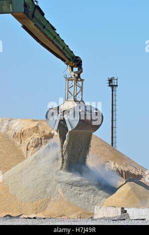 Excavator working on industrial construction site - Stock Photo