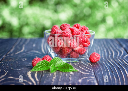 fresh raspberry on a wooden table - Stock Photo