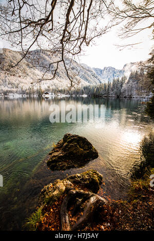 First snow of the winter at a lake in the italian alps - Stock Photo