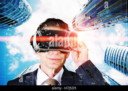Man with VR Headset in a virtual city - Stock Photo