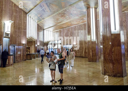 Manhattan New York City NYC NY Midtown 42nd Street Chrysler Building lobby marble Art Deco man woman couple ceiling - Stock Photo