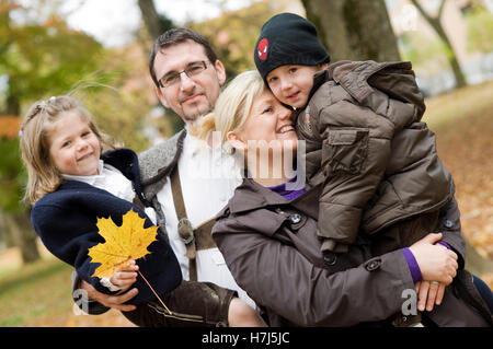 Family in autumn - Stock Photo