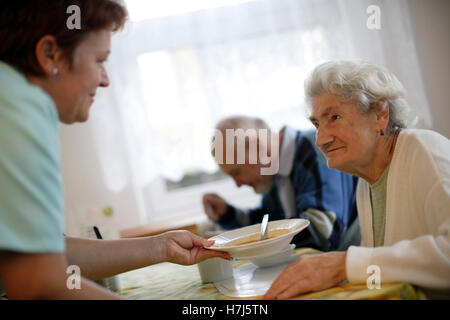 Old woman with nurse