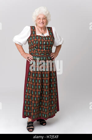 Elderly woman, 76, wearing a traditional costume - Stock Photo