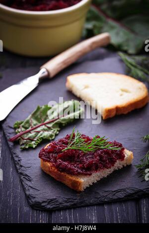 Beetroot caviar and toast. Selective focus - Stock Photo