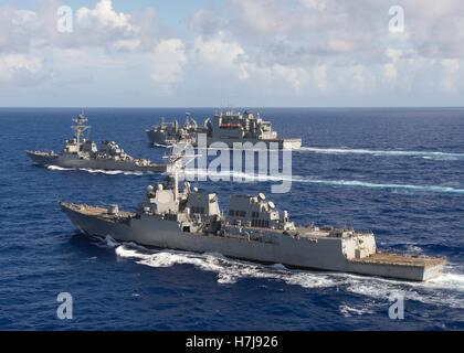 The USN Arleigh Burke-class guided-missile destroyers USS Spruance (front), USS Decatur and the USN Lewis and Clark - Stock Photo