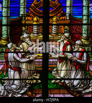 Stained Glass window depicting four Rabbis reading the Torah scrolls, in the Cathedral of Saint Rumbold in Mechelen, - Stock Photo